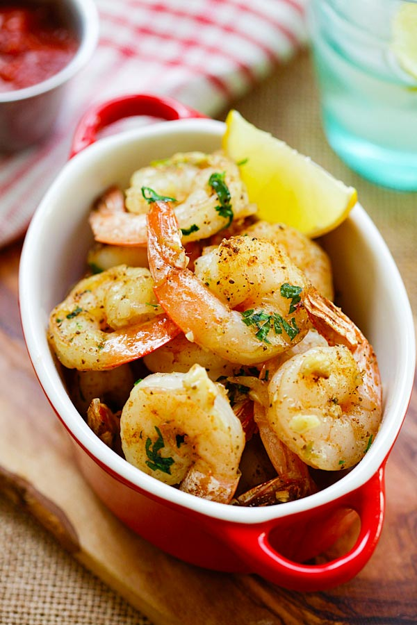 Easy and quick roasted shrimp with butter, garlic, herb and serve with cocktail sauce in serving dish.