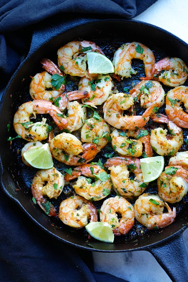 Cilantro Lime Shrimp with cilantro, lime and garlic on sizzling skillet.