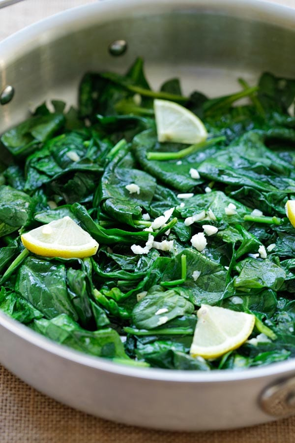 Easy and healthy garlic butter sauteed spinach recipe in a pot.