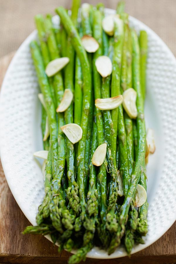 Homemade oven baked asparagus with garlic in a serving dish.