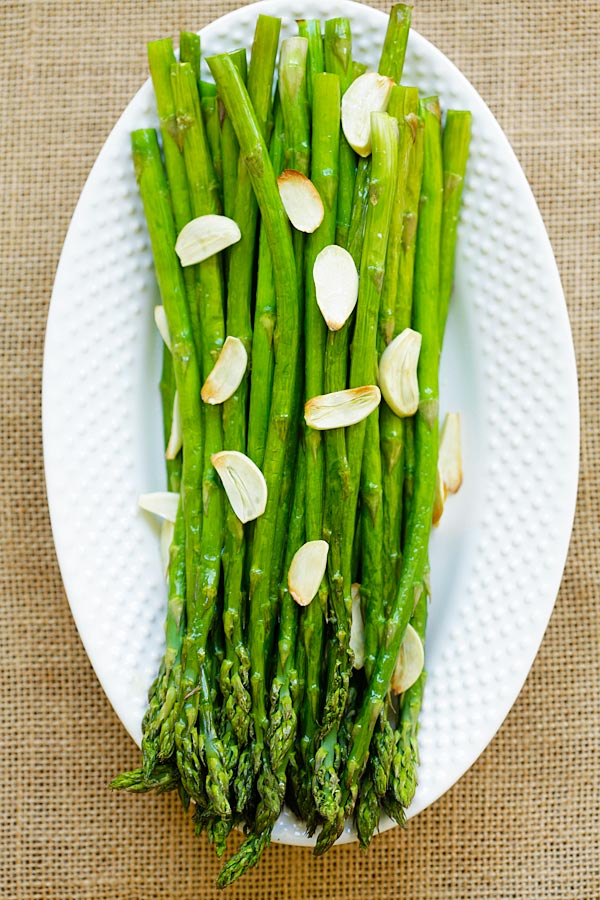 Top down view of healthy roasted asparagus with garlic.