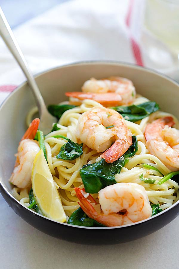 homemade spaghetti with shrimp and spinach in garlic butter sauce