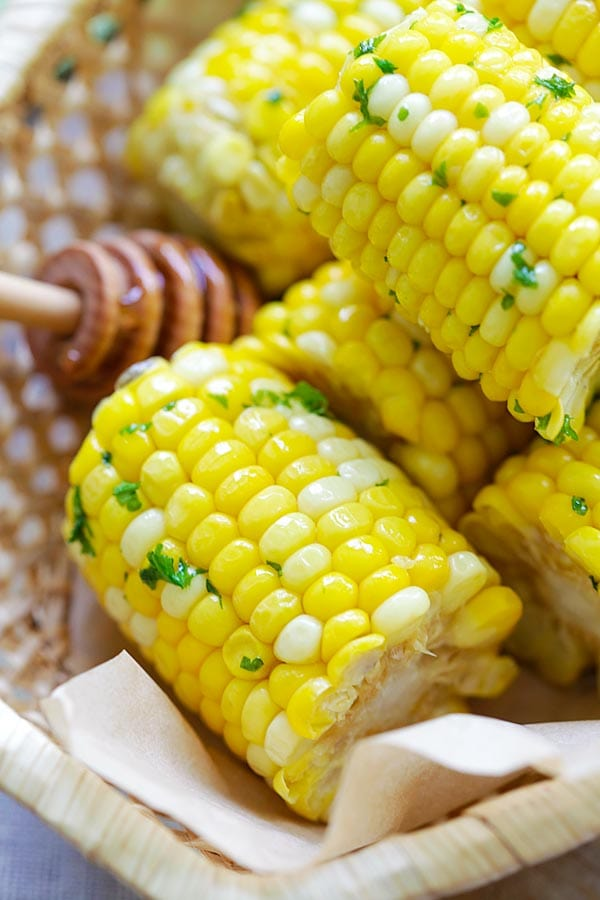 Close up sweet corns coated in buttery honey butter.