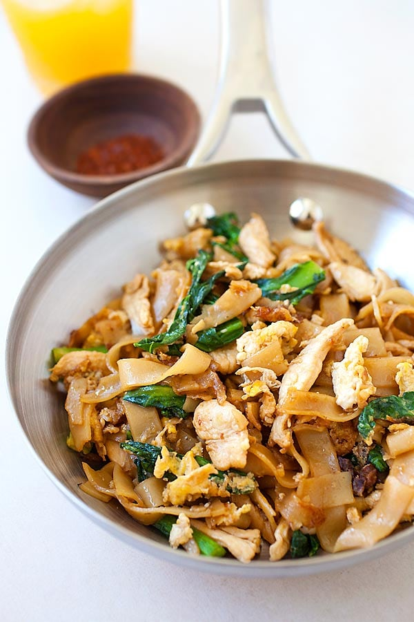 Delicious and easy chicken Pad See Ew or Pad Siew noodles in pad see ew sauce in a skillet, ready to be served.