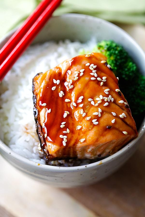 Salmon teriyaki in a Japanese bowl and served with a pair of chopsticks.