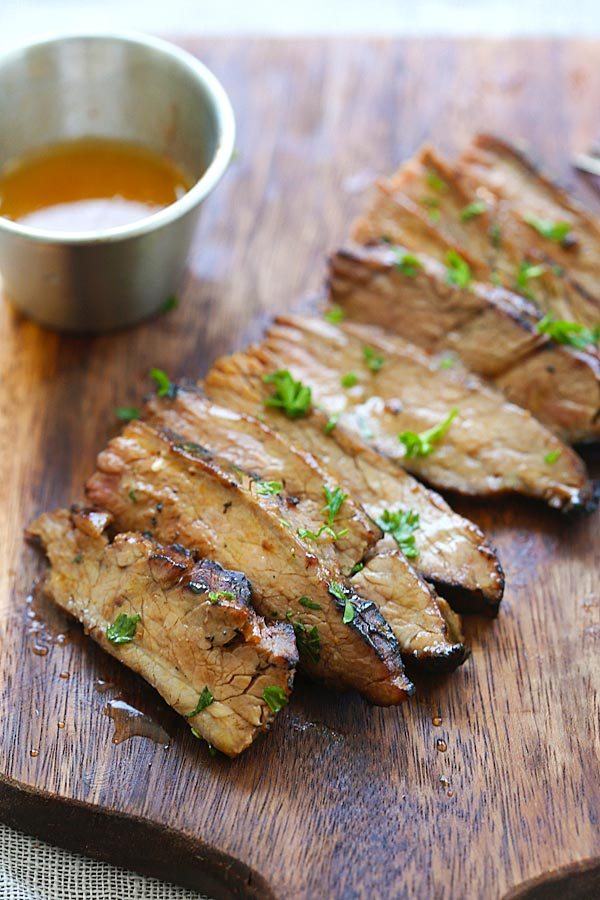 Easy and quick Honey Sriracha Flank Steak marinated with honey sriracha butter.