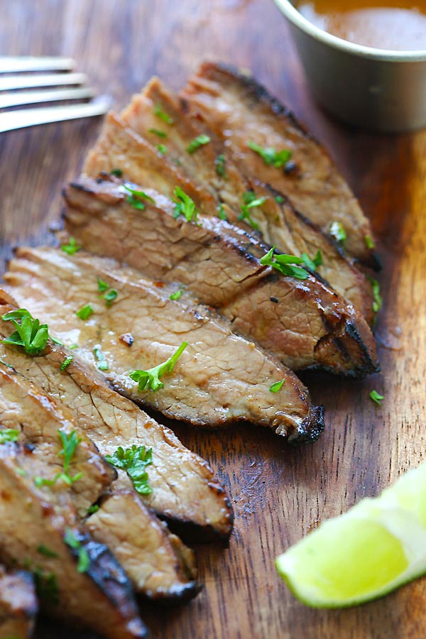 Tender and juicy steak marinated with honey sriracha butter sliced into pieces.