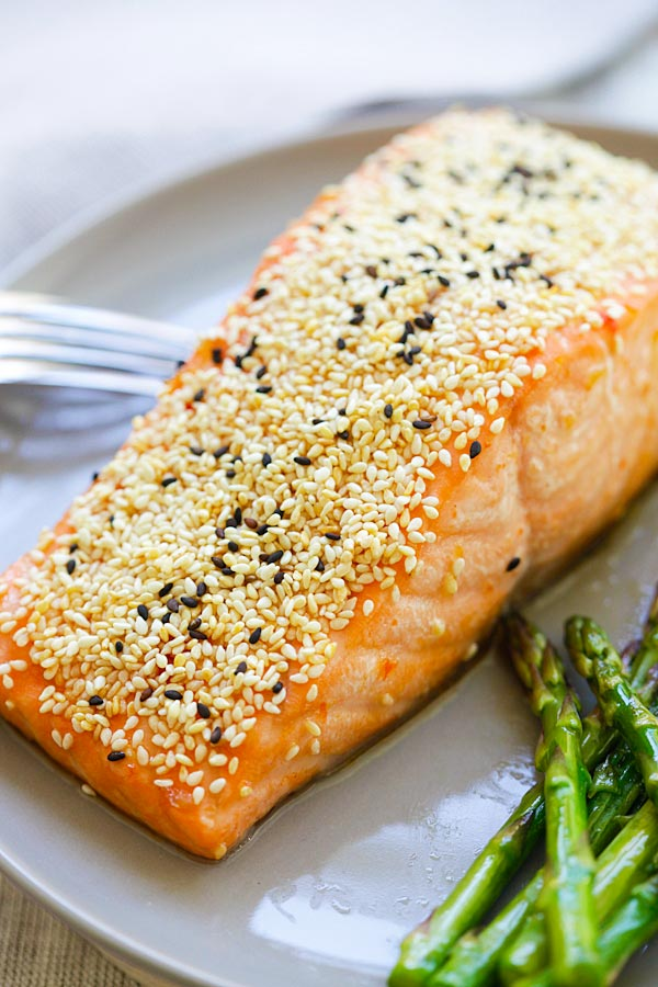 Close up of homemade healthy sesame coated salmon in a plate.