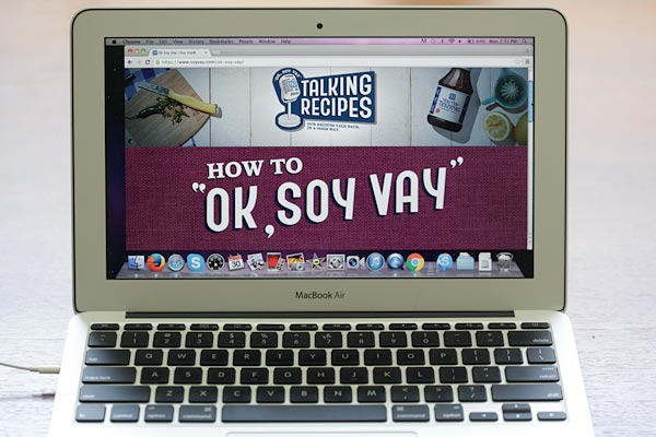 OK Soy Vay website in a notebook.