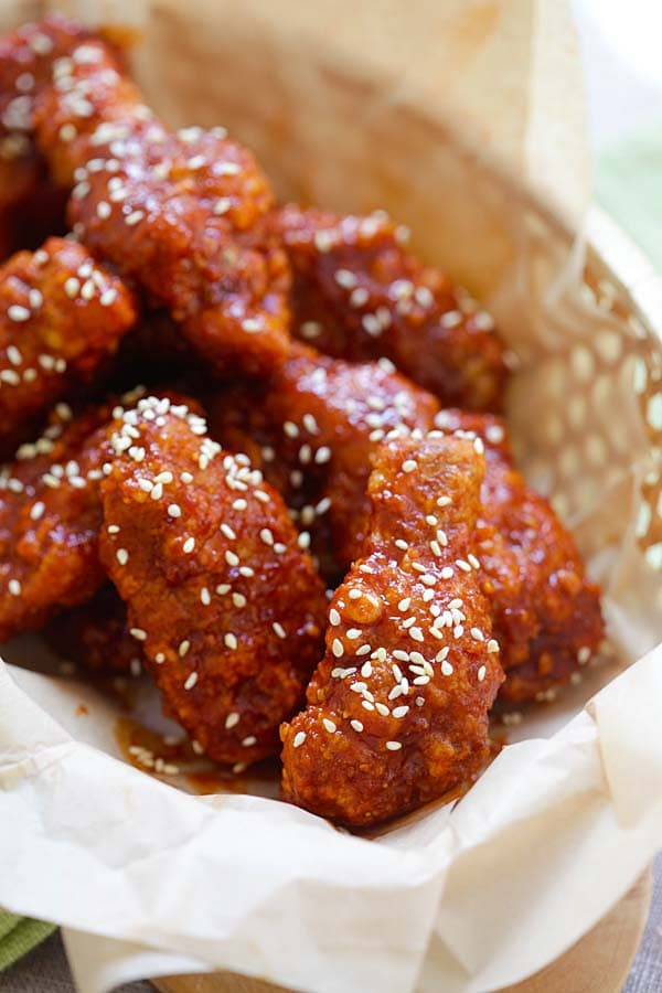 Korean Fried Chicken in serving basket topped with sesame seeds
