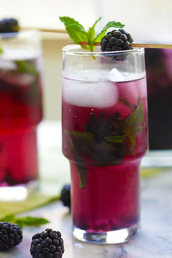 classic blackberry mojito with mint leaves and fresh blackberries, serve in a glass with ice.