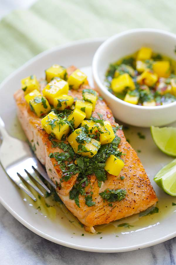 Chimichurri grilled salmon with mango in a plate.