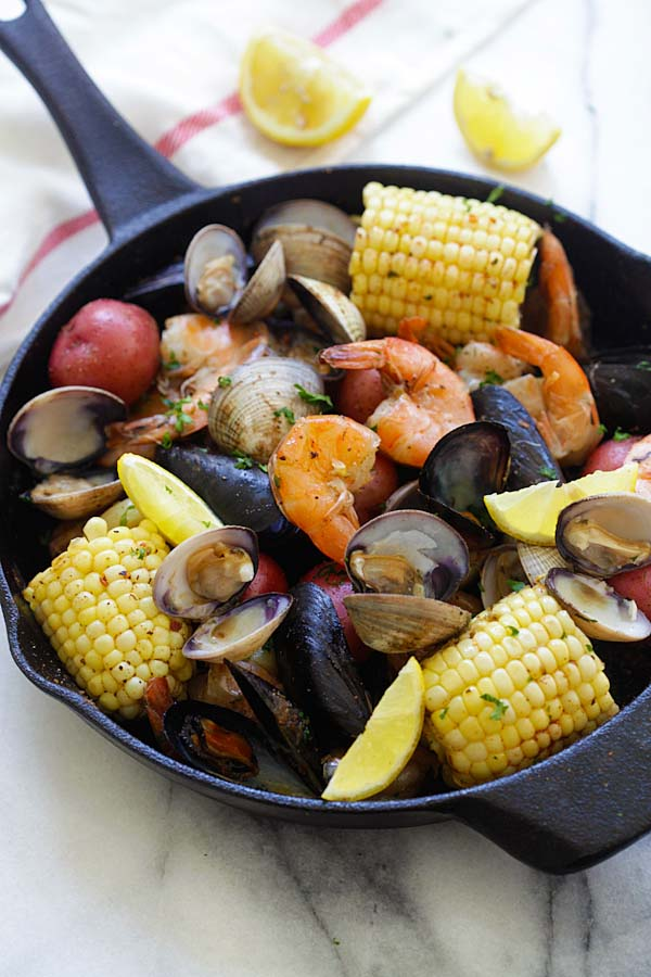 Clambake - the easiest and no-fuss clambake recipe ever, cooked on a stovetop with a skillet. Fresh, delicious and perfect for summer | rasamalaysia.com