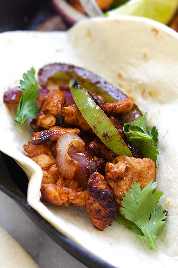 Healthy Mexican Chicken Fajita folded in a tortilla.