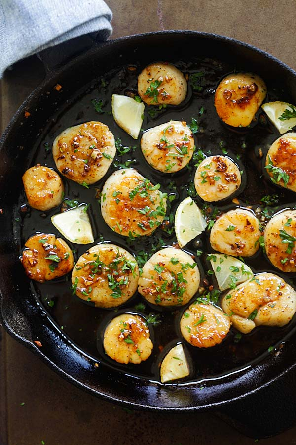 Easy and quick seared scallops with brown butter and honey garlic sauce.
