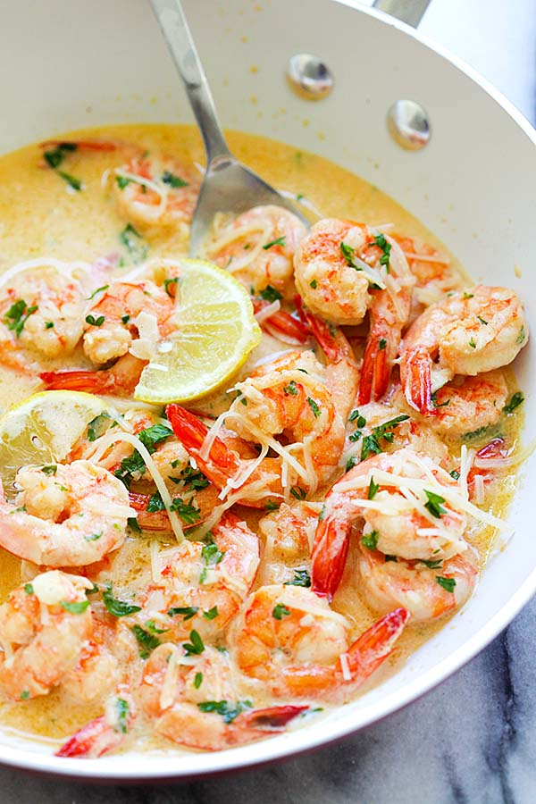 Homemade delicious lemon shrimp with rich, buttery, creamy garlic Parmesan sauce in a skillet.