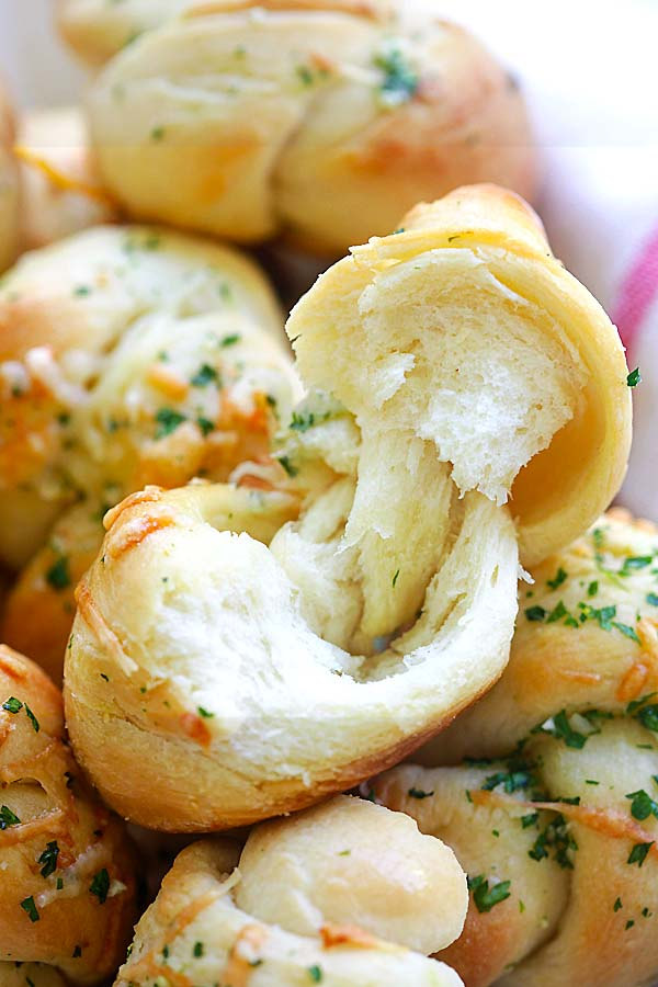 Easy baked dinner rolls with garlic and Parmesan cheese closed up.
