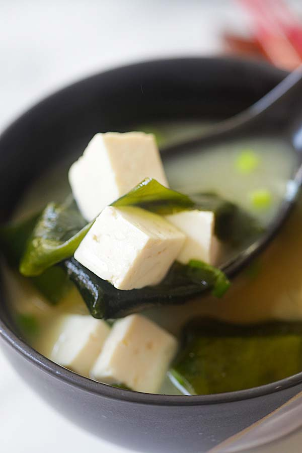 Vegan miso soup recipe with tofu, miso paste and seaweed.