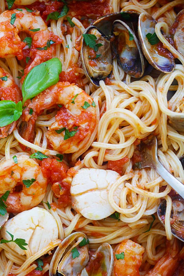 Mixed seafood pasta cooked in one pot with fresh tomato sauce, ready to serve.