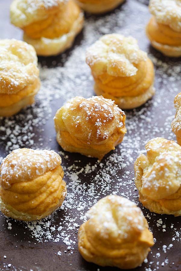 Festive puffy choux pastry filled with sweet pumpkin cream filling.