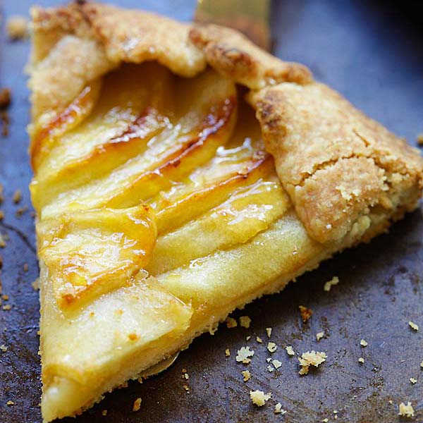 Slice of homemade apple tart on serving spatula.