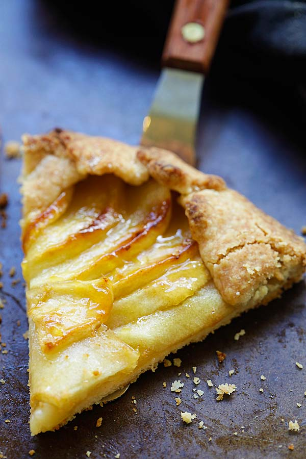 Close up of a slice of baked apple tart on serving spatula