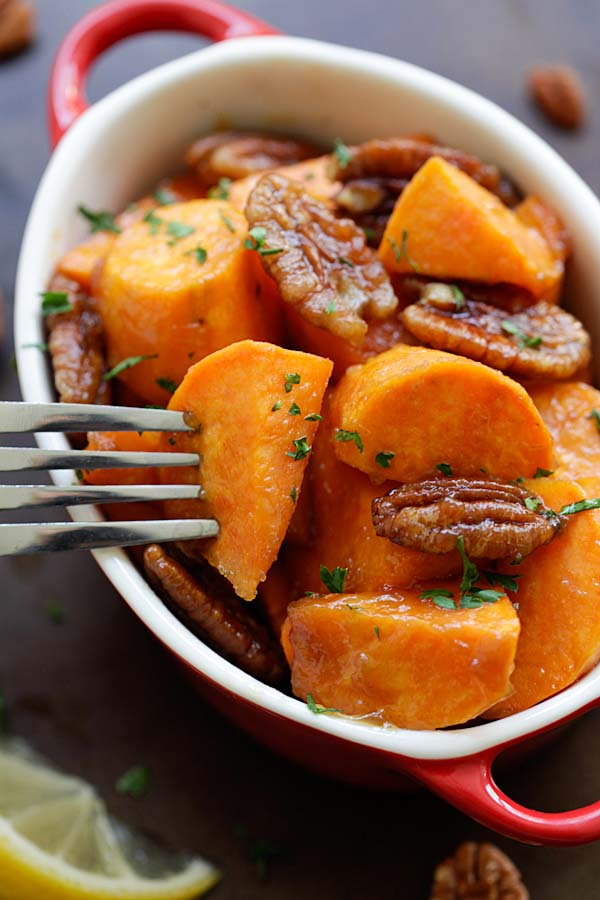 Easy oven-roasted sweet potatoes with a sticky sweet maple glaze and pecan, ready to serve.