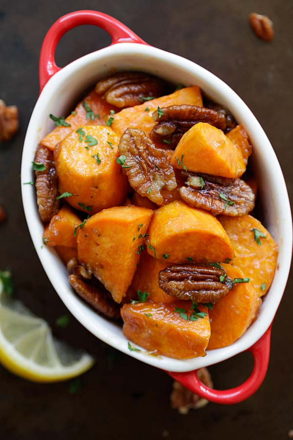 Top down view of healthy and delicious maple glazed roasted sweet potatoes with pecan.