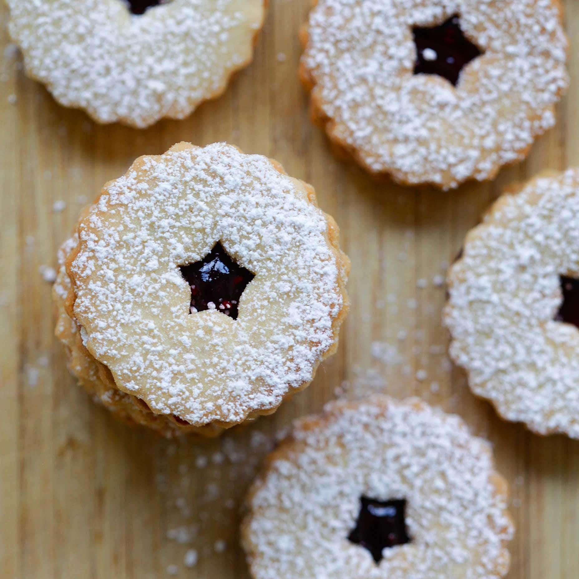 Linzer Cookies – buttery and crumbly Linzer Cookies recipe that is loaded with raspberry jam and dusted with powdered sugar. Must-bake for holidays | rasamalaysia.com