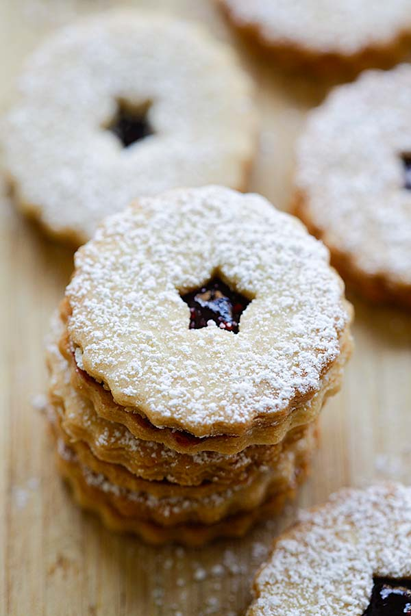 Easy homemade mini Linzer cookies made with raspberry jam and dusted with powdered sugar.