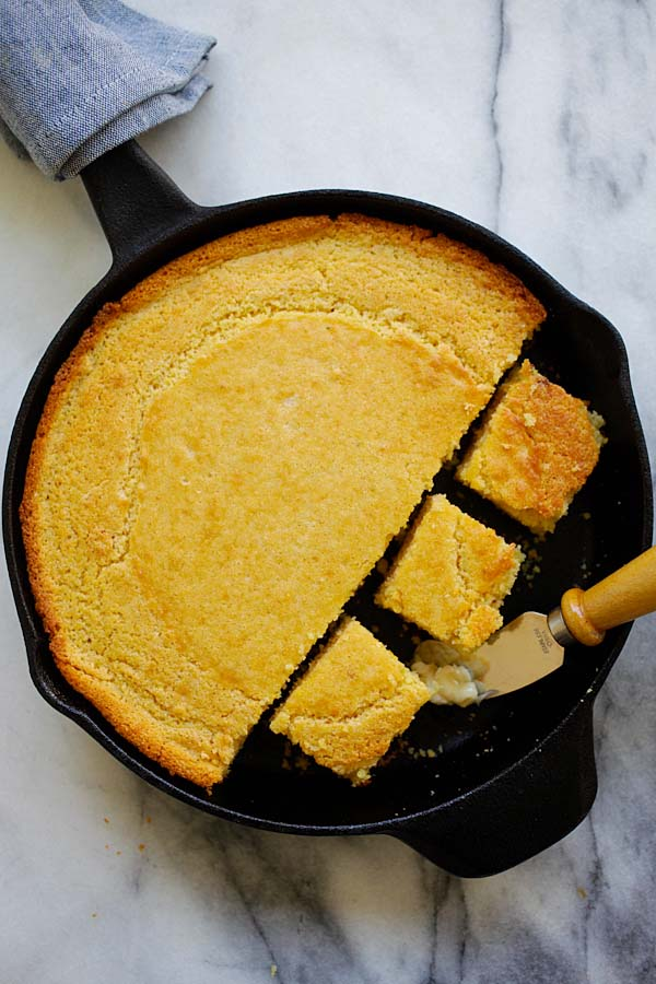 Easy cast-iron skillet corn bread bake in oven and served with whipped honey butter.
