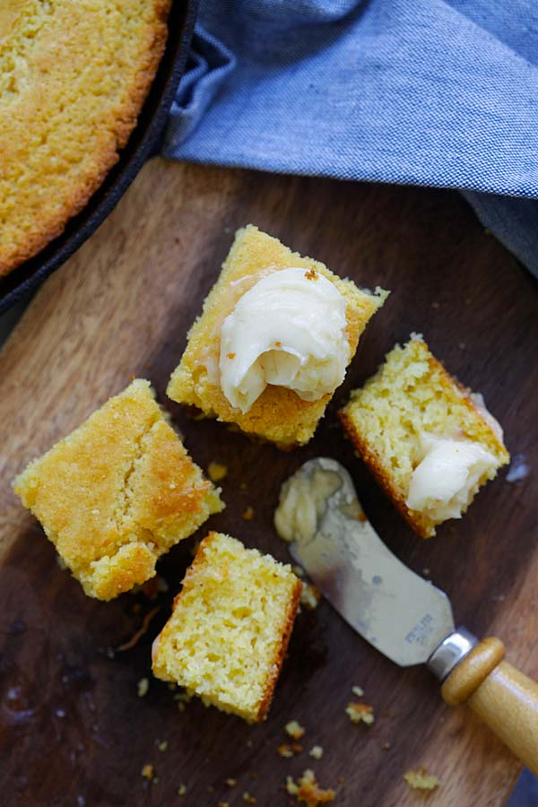 Easy and delicious corn bread sliced in cubes sizes and spread with honey butter.
