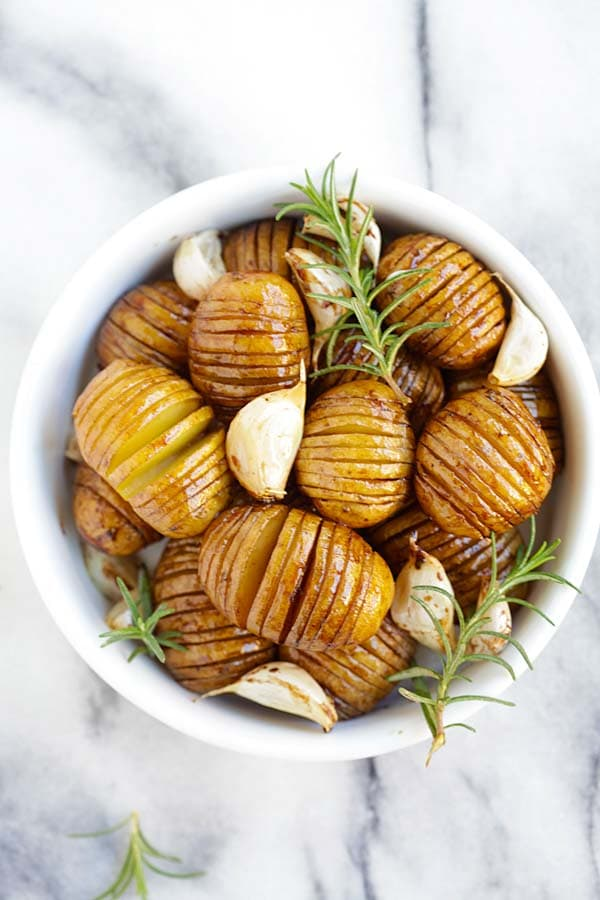 Easy and quick hasselback roasted potatoes with honey balsamic and garlic served in a bowl.