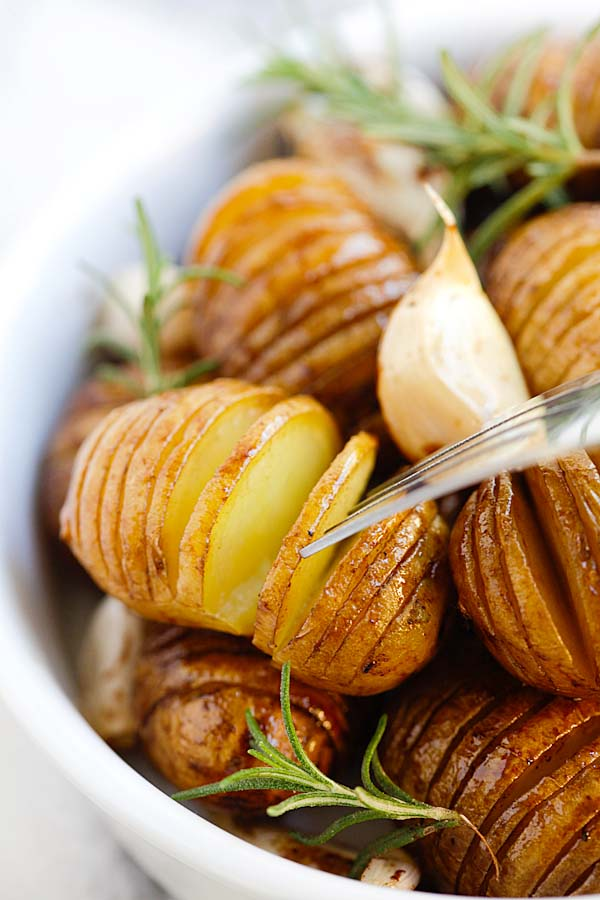 Easy garlic balsamic honey sauce roasted hasselback potatoes, ready to serve.