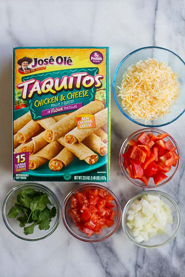 Mexican Taquitos ingredients that consists of Jose Ole Taquitos flour, diced onions, bell peppers, chopped tomatoes, shredded cheese and cilantro leaves.