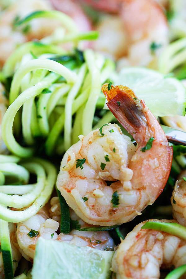 Closed up healthy zoodle salad with shrimps sauteed in brown butter, cilantro and lime juice.