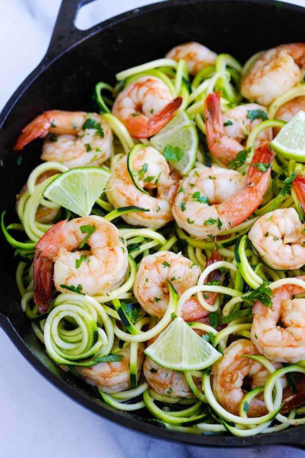 Easy and healthy homemade sauteed brown butter cilantro lime shrimp with grated zucchini salad.