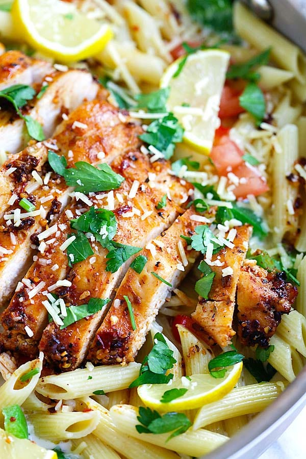 Easy and delicious creamy pasta with spicy blackened spice chicken breast garnished with shredded cheese.