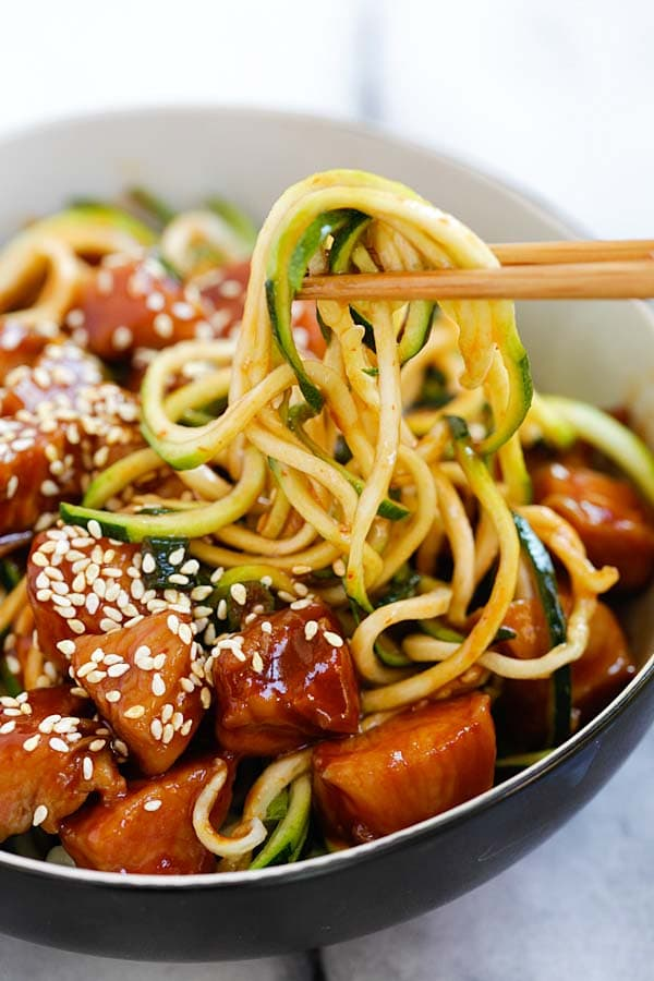 Easy and delicious homemade honey sriracha chicken zucchini noodles ready to serve.
