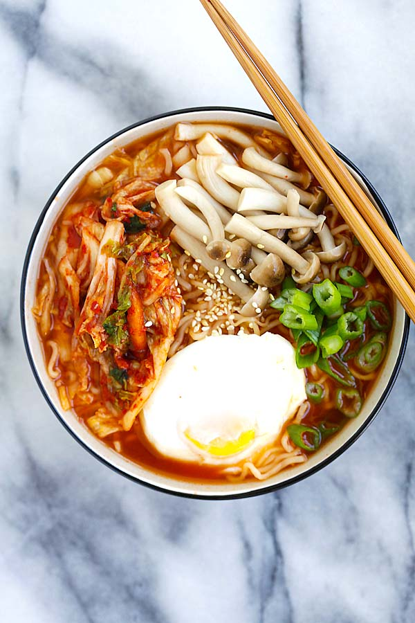 Easy spicy Korean ramen with kimchi, mushroom and poached egg in a bowl.