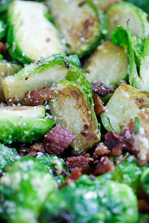 Easy and quick garlic Parmesan cheese and bacon Brussels sprouts roasted in a cast-iron skillet.