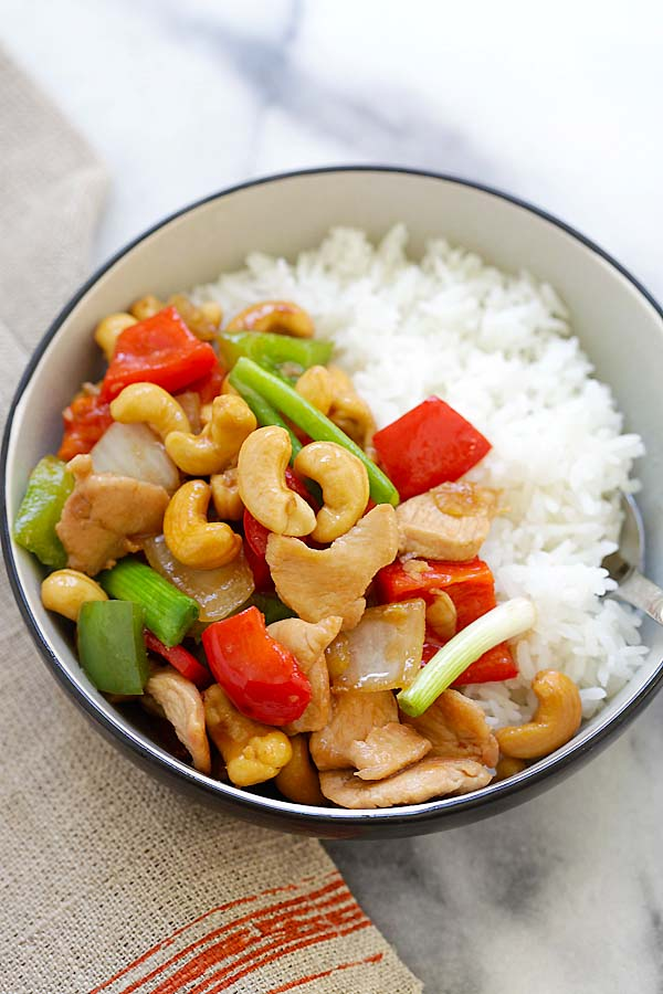 Thai stir-fry cashew nuts chicken served with a bowl of steamed rice.
