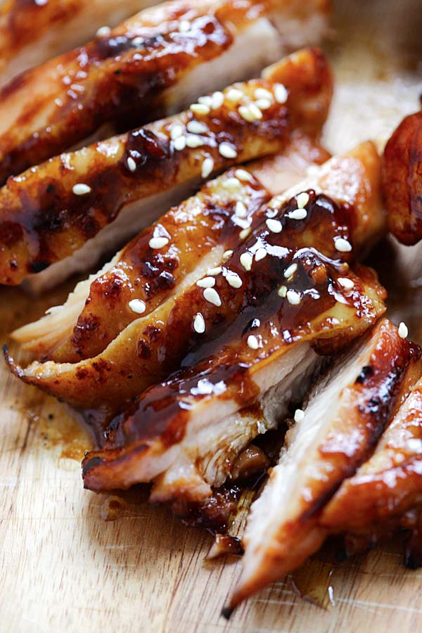 Tasty chicken marinade with hoisin, sriracha and honey garnished with sesame seeds, ready to serve.