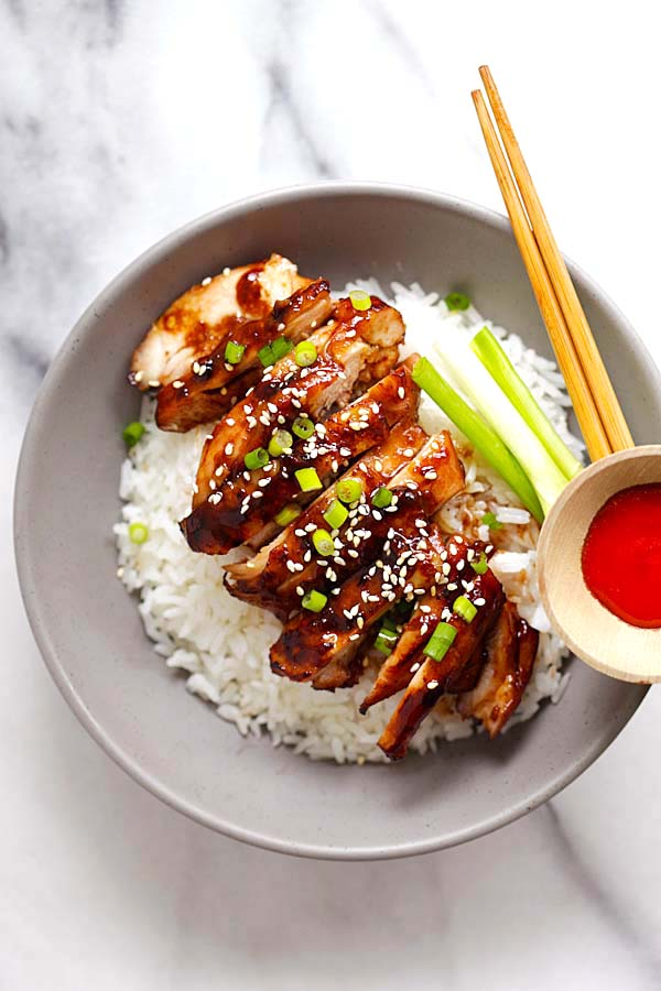 Easy and quick Asian soy-glazed chicken made with soy sauce, five spice powder and sugar served on top of rice in a bowl.