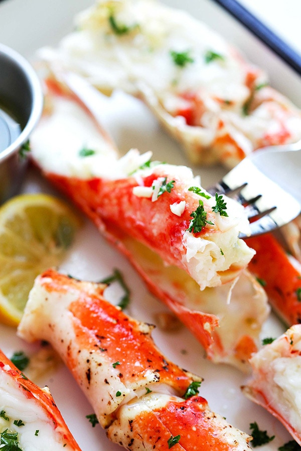 Garlic Lemon Butter Crab Legs - crazy delicious king crab legs in garlic herb and lemon butter. This crab legs recipe is so good you want it everyday | rasamalaysia.com