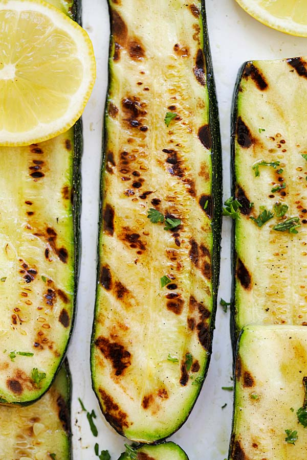 Grilled zucchini with skin on, with lemon butter and herb.