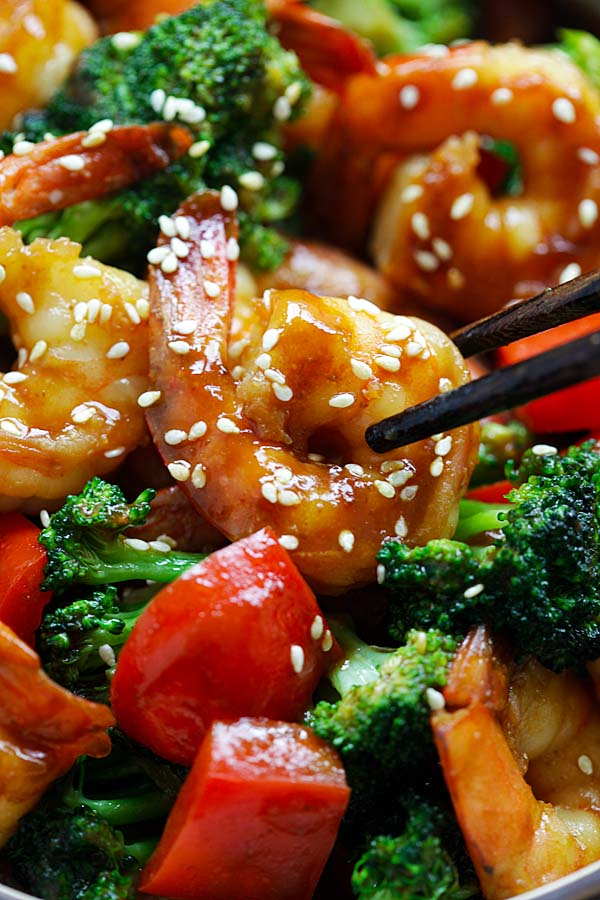 Homemade and easy Asian stir fry shrimp with broccoli with hoisin brown sauce.