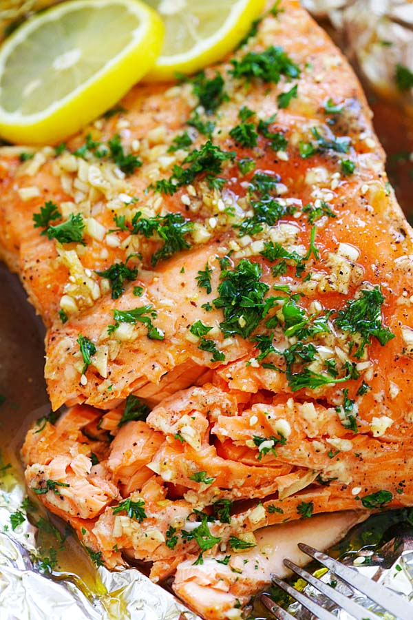 Easy and delicious oven roasted salmon with soy sauce and honey butterin aluminium foil, ready to serve.