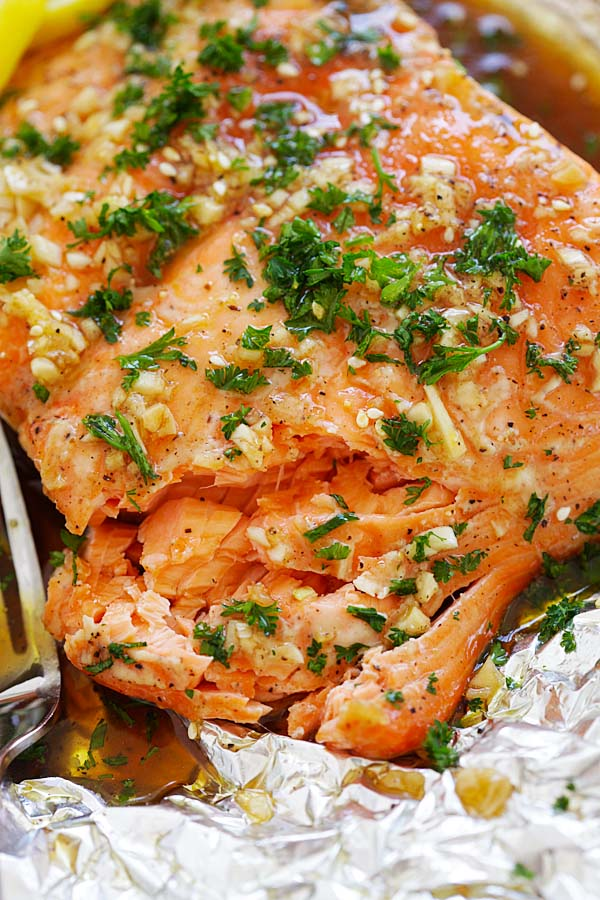 Close up flaky Soy Honey Butter Salmon in aluminium foil.