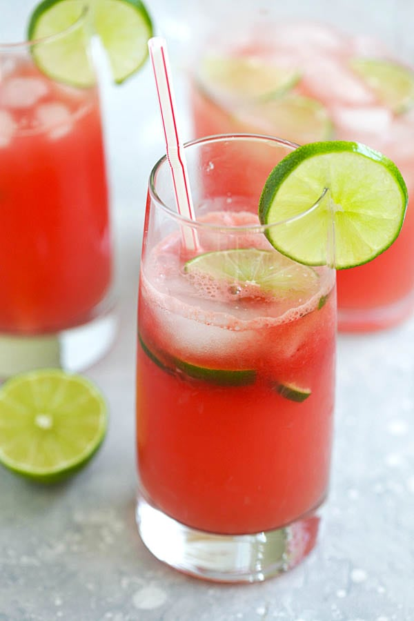Refreshing and easy iced watermelon limeade served in a glass with a straw.